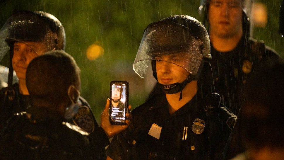 A police officer stands watch during a protest on September 03, 2020 in Rochester, New York. Daniel Prude died after being arrested on March 23, by Rochester police.