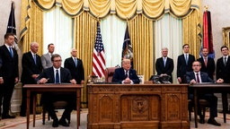 U.S. President Donald Trump (C) participates in a signing ceremony and meeting with the President of Serbia Aleksandar Vucic (L) and the Prime Minister of Kosovo Avdullah Hoti (R) in the Oval Office of the White House on September 4, 2020 in Washington, DC.