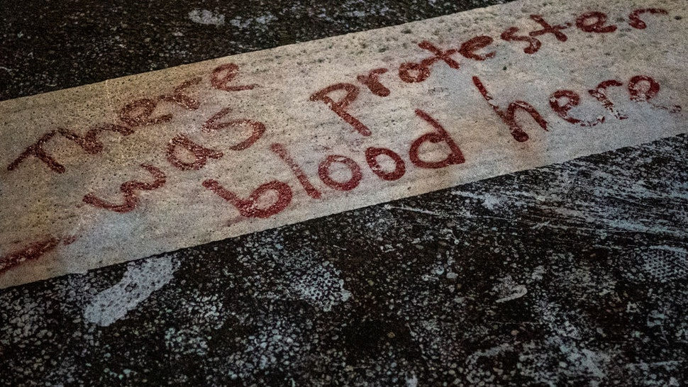 PORTLAND, OR - SEPTEMBER 5: The words There was protester blood here are seen here in a crosswalk after Portland police injured a woman during an arrest early in the morning on September 5, 2020 in Portland, Oregon. Friday night marked the 99th night of protests in Portland following the death of George Floyd in police custody. (Photo by Nathan Howard/Getty Images)