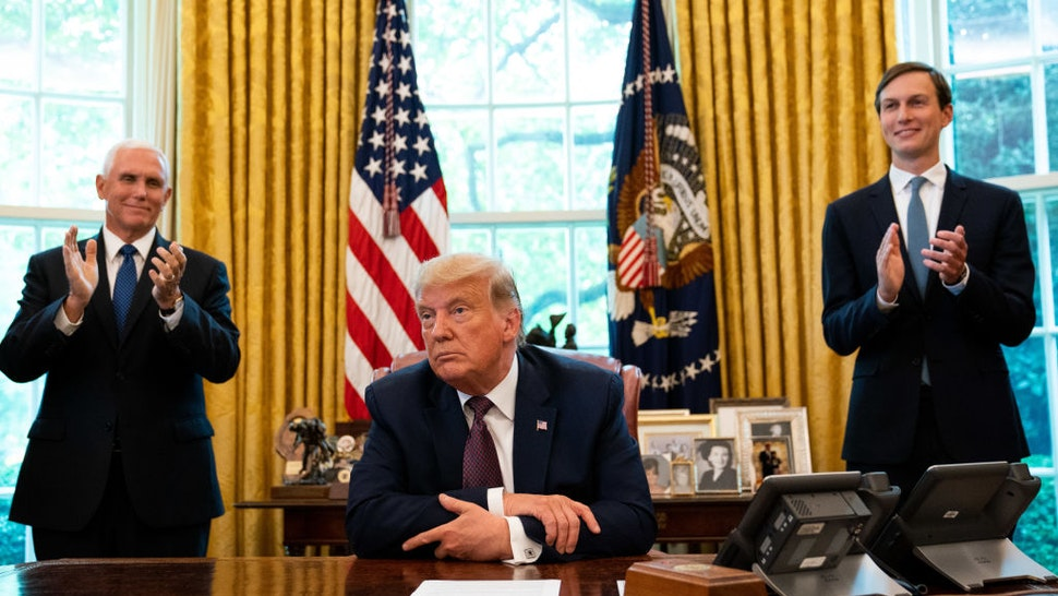 U.S. President Donald Trump, flanked by U.S. Vice President Mike Pence (L) and Advisor Jared Kushner, speaks in the Oval Office to announce that Bahrain will establish diplomatic relations with Israel, at the White House in Washington, DC on September 11, 2020.