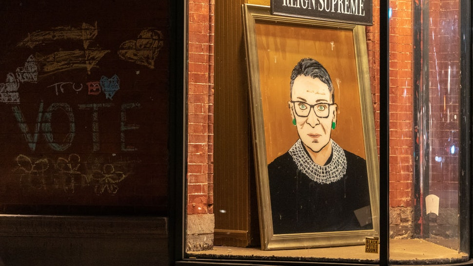 NEW YORK, NY - SEPTEMBER 19: A portrait of Supreme Court Justice Ruth Bader Ginsburg is displayed at a storefront on September 19, 2020 in New York, New York. Ginsburg has died at age 87 after a battle with pancreatic cancer. (Photo by Jeenah Moon/Getty Images)