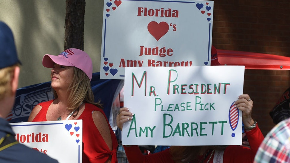 People holding placards in support of Judge Amy Coney Barrett as a potential nominee for Supreme Court Justice as supporters of U.S President Donald Trump arrive at a Great American Comeback campaign rally at the Jacksonville JetPort at Cecil Airport.