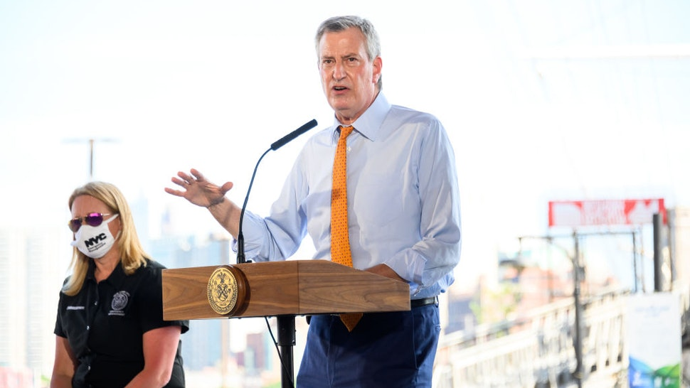 NEW YORK, NEW YORK - AUGUST 03: New York City Mayor Bill de Blasio speaks at South Street Seaport as workers erect temporary flood barriers in preparation for potential flooding and a storm surge from Tropical Storm Isaias on August 03, 2020 in New York City. The storm, which is heading up the East Coast packing heavy winds, is expected to dump several inches of rain on the metro area starting late this evening and into tomorrow. The interlocking tubes, called Tiger Dams, are installed in areas that were heavily damaged from flooding during Hurricane Sandy. (Photo by Noam Galai/Getty Images)