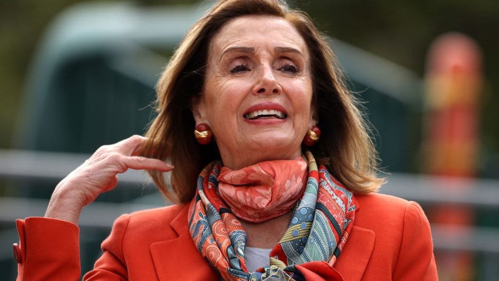U.S. Speaker of the House Nancy Pelosi (D-CA) adjusts her hair as she speaks during a Day of Action For the Children event at Mission Education Center Elementary School on September 02, 2020 in San Francisco, California.