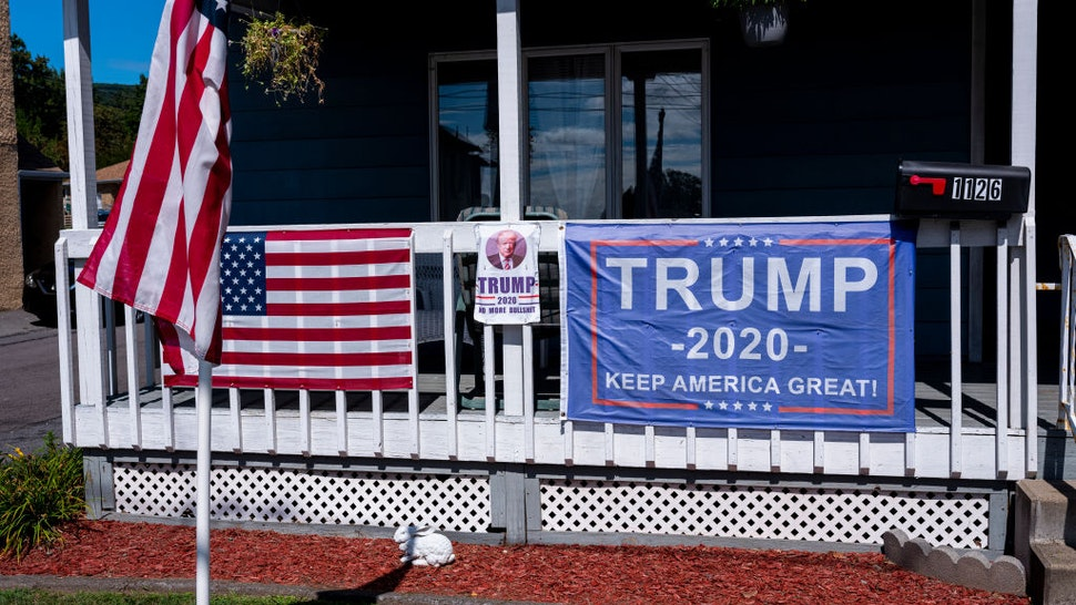 Political posters favoring U.S. presidential candidate President Donald Trump are attached to a railing September 11, 2020 in Scranton, Pennsylvania.