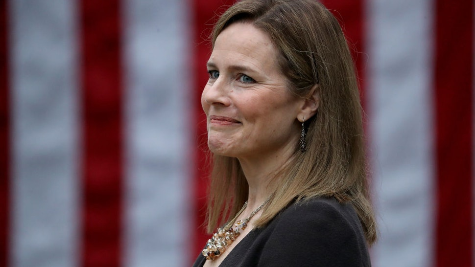 WASHINGTON, DC - SEPTEMBER 26: Seventh U.S. Circuit Court Judge Amy Coney Barrett looks on while being introduced by U.S. President Donald Trump as his nominee to the Supreme Court during an event in the Rose Garden at the White House September 26, 2020 in Washington, DC. With 38 days until the election, Trump tapped Barrett to be his third Supreme Court nominee in just four years and to replace the late Associate Justice Ruth Bader Ginsburg, who will be buried at Arlington National Cemetery on Tuesday. (Photo by Chip Somodevilla/Getty Images)