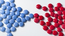 Blue candy with colorful red chocolates - stock photo