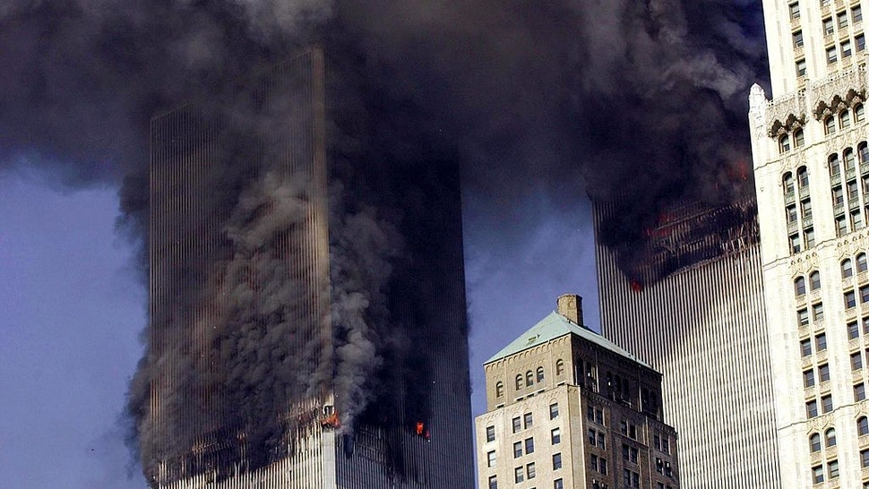 The twin towers of World Trade Center burn after two planes crashed into each building 11 September, 2001, in New York.