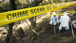 Crime - Scene Investigators Searching Grave Site - stock photo