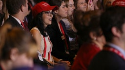 Young people listen to U.S. President Donald Trump as he addresses the Conservative Political Action Conference at the Gaylord National Resort and Convention Center February 23, 2018 in National Harbor, MD.