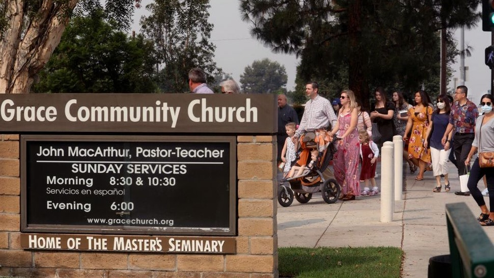 Grace Community Church parishioners make their way to Sunday service in Sun Valley on September 13, 2020. The church held a packed morning service today, defying a court order directing them to refrain from holding indoor services due to the COVID-19 pandemic. (Genaro Molina/Los Angeles Times)