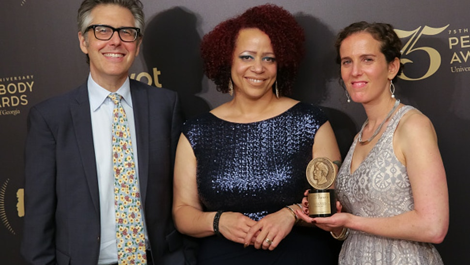 """NEW YORK, NY - MAY 21: Official recipients for """"The Case for School Desegregation Today-This American Life"""", (L-R) host and executive producer Ira Glass, reporter Nikole Hannah-Jones and producer Chana Joffe-Walt pose for photographs in the press room during the 75th Annual Peabody Awards Ceremony held at Cipriani Wall Street on May 21, 2016 in New York City."""