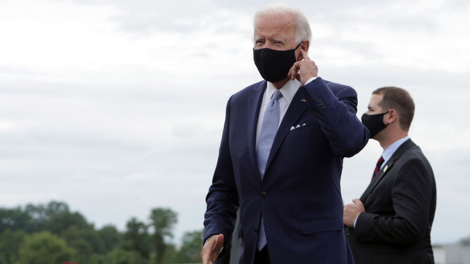 WEST MIFFLIN, PENNSYLVANIA - on August 31: Democratic presidential candidate former Vice President Joe Biden gestures after he landed at Allegheny County Airport on August 31, 2020 in West Mifflin, Pennsylvania. Biden is traveling to Pittsburgh today and will speak on the protests against racism and police violence in Kenosha, Wisconsin and Portland, Oregon. (Photo by Alex Wong/Getty Images)