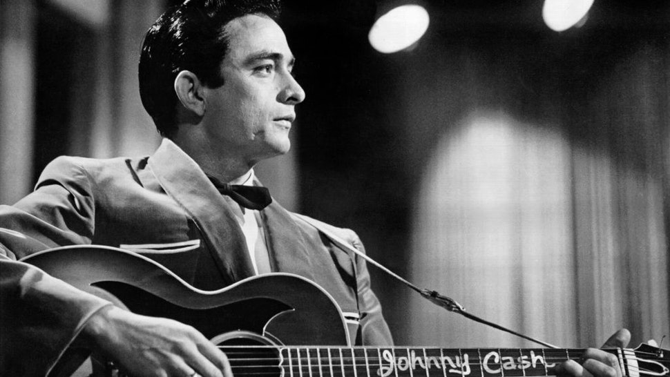 Country singer/songwriter Johnny Cash performs onstage with an acoustic guitar in Sun Records publicity shot in 1957. (Photo by Michael Ochs Archives/Getty Images)