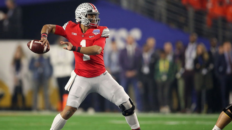 GLENDALE, ARIZONA - DECEMBER 28: Quarterback Justin Fields #1 of the Ohio State Buckeyes throws a pass during the PlayStation Fiesta Bowl against the Clemson Tigers at State Farm Stadium on December 28, 2019 in Glendale, Arizona. The Tigers defeated the Buckeyes 29-23. (Photo by Christian Petersen/Getty Images)