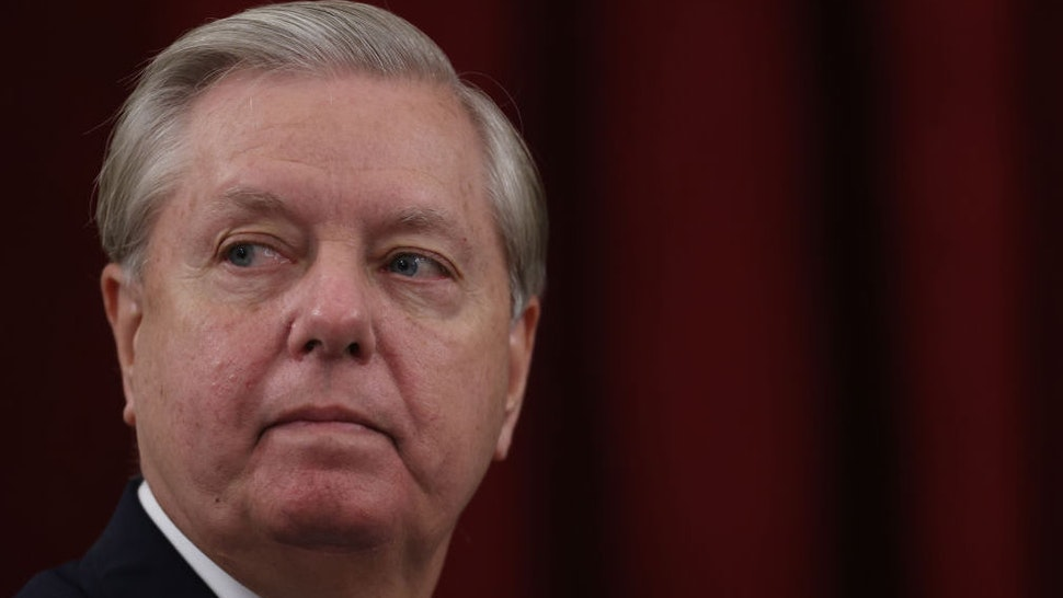 WASHINGTON, DC - SEPTEMBER 24: Sen. Lindsey Graham (R-SC), Chairman of the Senate Judiciary Committee, listens to colleagues speak during a committee hearing on September 24, 2020 in Washington, DC. Graham will preside over the committee at the center of a contentious process in the U.S. Senate as U.S. President Donald Trump nominates a new Supreme Court Justice in the wake of Associate Justice Ruth Bader Ginsburg's death.