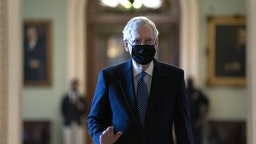 Senate Majority Leader Mitch McConnell, a Republican from Kentucky, center, wears a protective mask as he walks to his office at the U.S. Capitol in Washington, D.C., U.S., on Tuesday, Sept. 15, 2020. A 50-member group of House Democrats and Republicans will release a $1.52 trillion coronavirus stimulus plan today in a long-shot attempt to break a months-long deadlock on providing relief to the pandemic-battered U.S. economy.