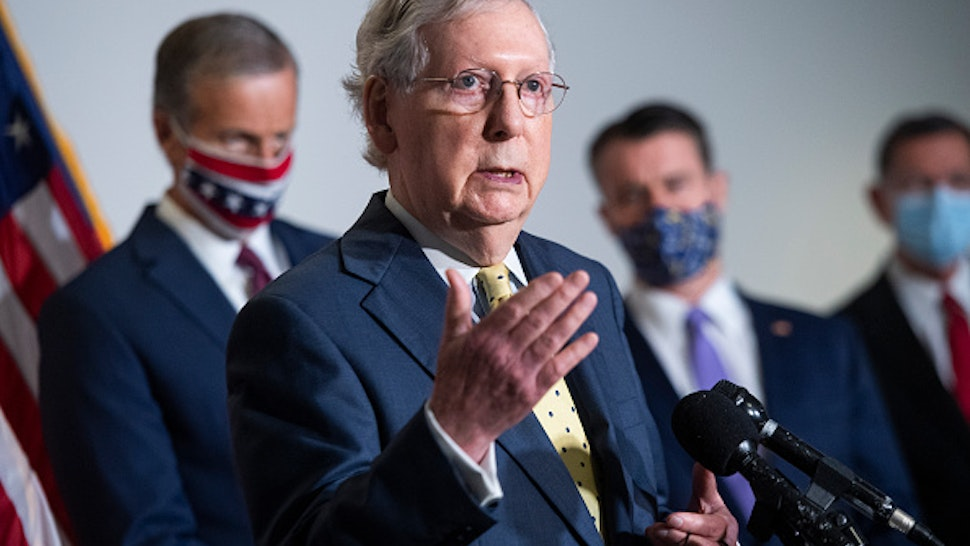 UNITED STATES - SEPTEMBER 9: Senate Majority Leader Mitch McConnell, R-Ky., conducts a news conference after the Senate Republican Policy luncheon in Hart Building on Wednesday, September 9, 2020. Also appearing from left are, Sens. John Thune, R-S.D., Todd Young, R-Ind., and John Barrasso, R-Wyo.