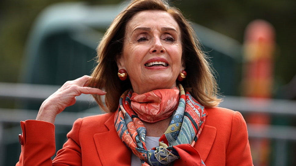 SAN FRANCISCO, CALIFORNIA - SEPTEMBER 02: U.S. Speaker of the House Nancy Pelosi (D-CA) adjusts her hair as she speaks during a Day of Action For the Children event at Mission Education Center Elementary School on September 02, 2020 in San Francisco, California. Nancy Pelosi is drawing criticism for patronizing a hair salon to get her hair done despite the salon being closed to in-person visits due to COVID-19 restrictions.
