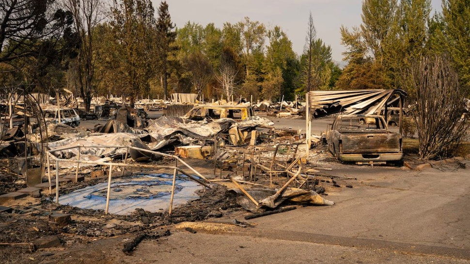PHOENIX, OR - SEPTEMBER 10: A damaged trampoline sits in a mobile home park destroyed by fire on September 10, 2020 in Phoenix, Oregon. Hundreds of homes in the town have been lost due to wildfire.