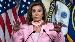 US Speaker of the House, Nancy Pelosi, Democrat of California, speaks during a press conference before the vote on the 'Delivering for America Act' to protect the postal system, on Capitol Hill in Washington, DC, on August 22, 2020.