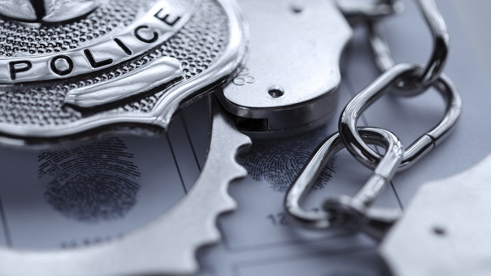 Police badge and cuffs (amphotora/Getty Images)