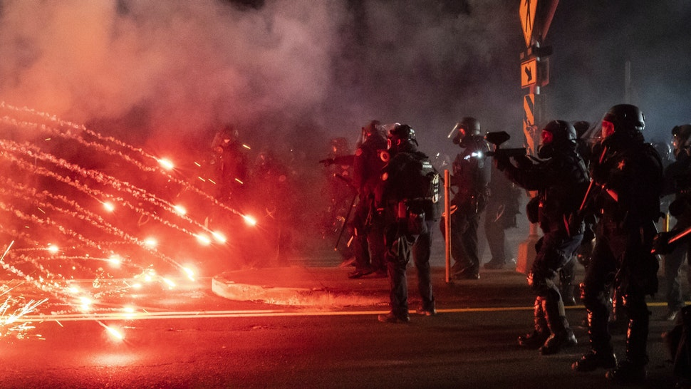 PORTLAND, OREGON - SEPTEMBER 5: Oregon State Troopers and Portland police advance through tear gas and fire works while dispersing a protest against police brutality and racial injustice on September 5, 2020 in Portland, Oregon. Portland has seen nightly protests for the past 100 days following the death of George Floyd in police custody.