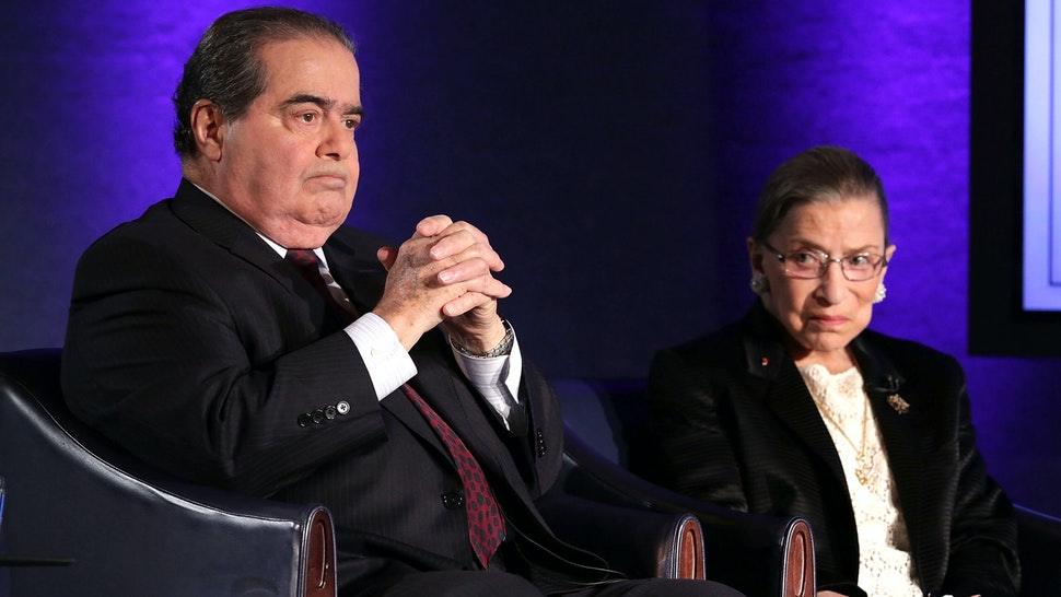 """WASHINGTON, DC - APRIL 17: Supreme Court Justices Antonin Scalia (L) and Ruth Bader Ginsburg (R) wait for the beginning of the taping of """"The Kalb Report"""" April 17, 2014 at the National Press Club in Washington, DC. The Kalb Report is a discussion of media ethics and responsibility at the National Press Club held each month."""