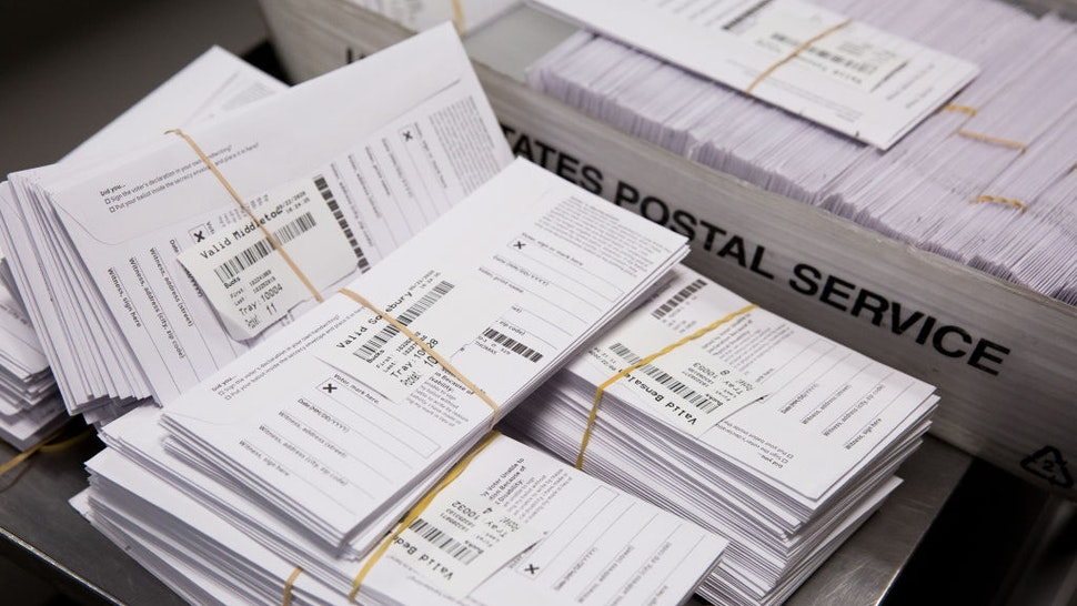 Sample voting ballots sit in a pile during a training on a new ballot sorting machine at the Board of Elections in Doylestown, Pennsylvania, U.S., on Tuesday, Sept. 22, 2020. Pennsylvania is taking steps to scale up for the November 3 election. Counties are investing millions of dollars on new ballot sorters, high-speed scanners and other equipment and staff to handle the projected 3 million mail-in ballots for November 3. Photographer: Rachel Wisniewski/Bloomberg via Getty Images