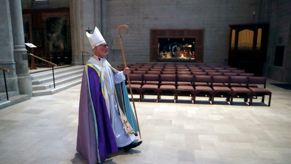 SAN FRANCISCO, CA - APRIL 12: Bishop Marc Andrus processes to altar during virtual Easter Sunday service at an empty Grace Cathedral in San Francisco, Calif., on Sunday, April 12, 2020.