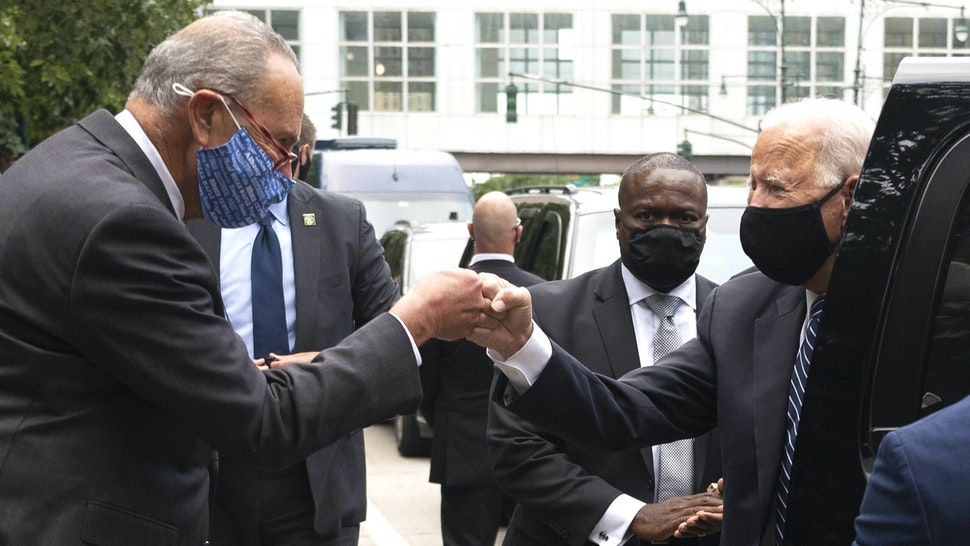 Democratic Presidential Candidate Joe Biden (C) bumps fists with US Senator Chuck Schumer (L) as he arrives at the 9/11 Memorial in New York on September 11, 2020. - Biden travels to New York and then Shanksville to attend 19th anniversary commemorations for the 9/11 attacks.