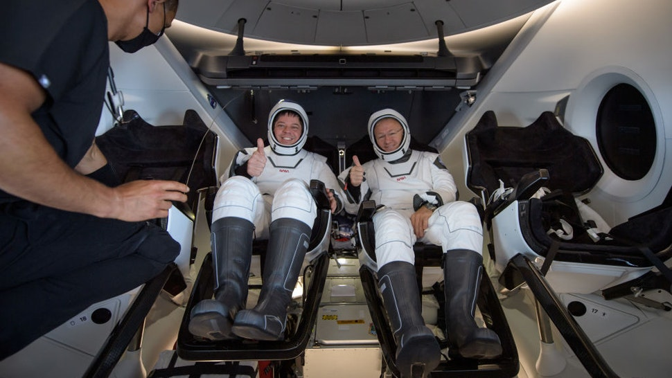 In this handout image provided by NASA, NASA astronauts Robert Behnken (L) and Douglas Hurley are seen inside the SpaceX Crew Dragon capsule spacecraft which landed in the Gulf of Mexico after completing the Demo-2 mission to the International Space Station on August 2, 2020 off the coast of Pensacola, Florida. The Demo-2 mission is the first launch with astronauts of the SpaceX Crew Dragon spacecraft and Falcon 9 rocket to the International Space Station as part of the agency's Commercial Crew Program. The test flight serves as an end-to-end demonstration of SpaceXs crew transportation system. Behnken and Hurley launched at 3:22 p.m. EDT on Saturday, May 30, from Launch Complex 39A at the Kennedy Space Center. A new era of human spaceflight is set to begin as American astronauts once again launch on an American rocket from American soil to low-Earth orbit for the first time since the conclusion of the Space Shuttle Program in 2011. (Photo by Bill Ingalls/NASA via Getty Images)