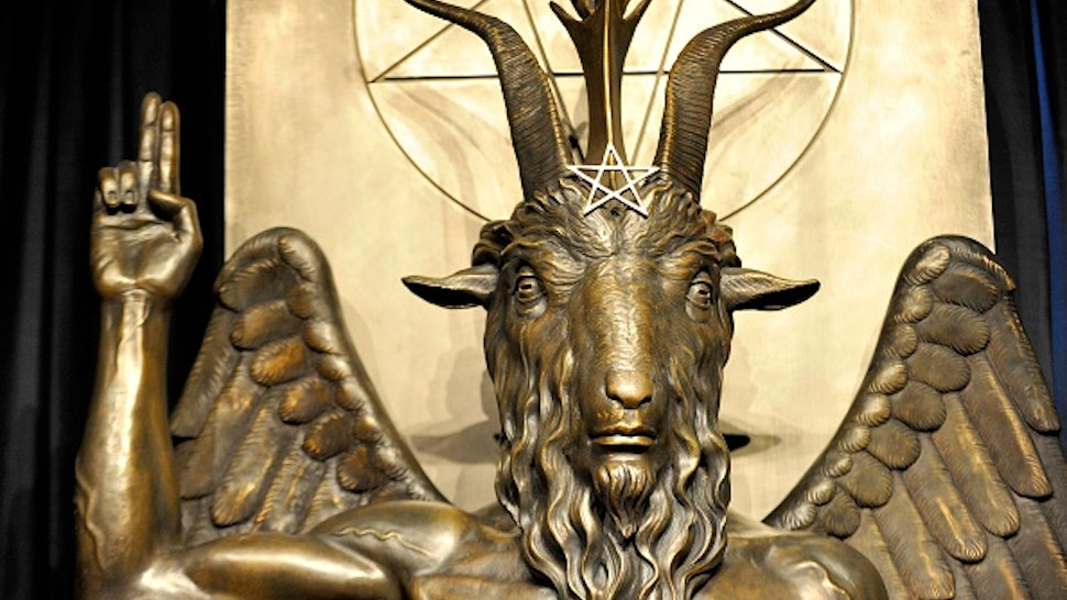 """The Baphomet statue is seen in the conversion room at the Satanic Temple where a """"Hell House"""" is being held in Salem, Massachusett on October 8, 2019. - The Hell House was a parody on a Christian Conversion centre meant to scare atheist and other Satanic Church members."""