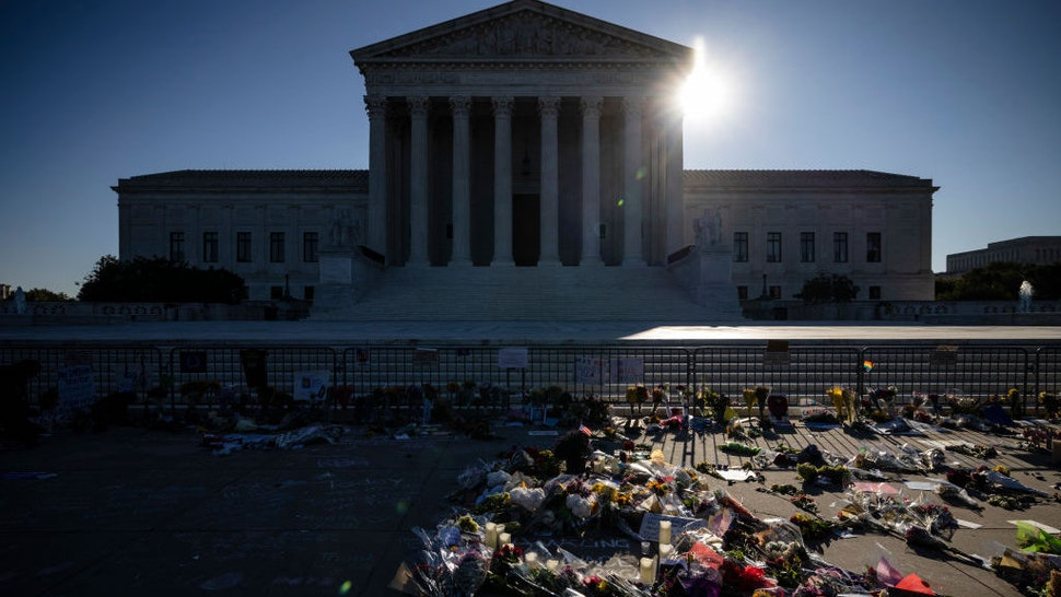 WASHINGTON, DC - SEPTEMBER 20: People place flowers at a makeshift memorial to honor Supreme Court Justice Ruth Bader Ginsburg in front of the US Supreme Court on September 20, 2020 in Washington, DC. Justice Ginsburg has died at age 87 after a battle with pancreatic cancer. (Photo by Samuel Corum/Getty Images)