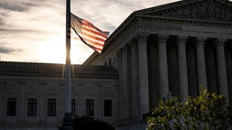 WASHINGTON, DC - SEPTEMBER 19: The American flag flies at half staff the morning after the death of Supreme Court Justice Ruth Bader Ginsburg in front of the US Supreme Court on September 19, 2020 in Washington, DC. Justice Ginsburg has died at age 87 after a battle with pancreatic cancer.