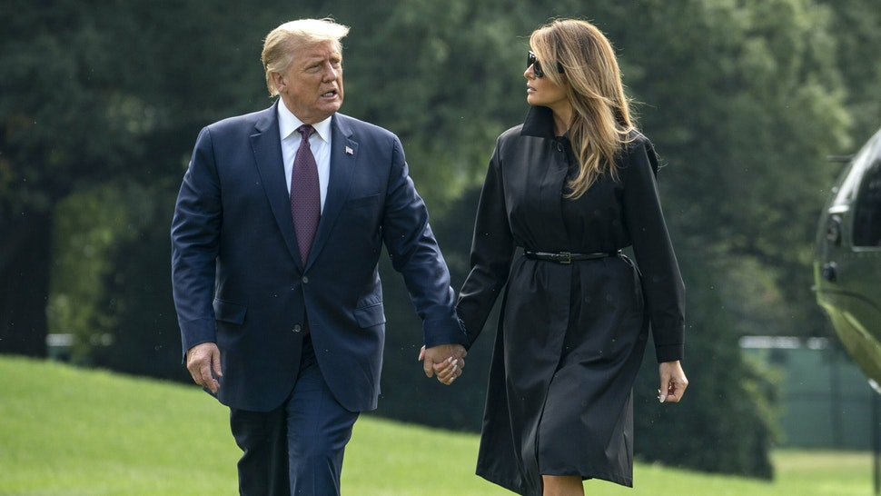 WASHINGTON, DC - SEPTEMBER 11: U.S. President Donald Trump and first lady Melania Trump walk to the White House residence as they exit Marine One on the South Lawn of the White House on September 11, 2020 in Washington, DC. President Trump and the First Lady traveled earlier to the Flight 93 National Memorial in Shanksville, Pennsylvania to mark the 19th anniversary of the September 11th attacks.