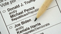 In this photo illustration a pencil lies on a U.S. presidential election mail-in ballot received by a U.S. citizen living abroad that shows current U.S. Republican President Donald Trump and his main contender, Democratic presidential candidate Joe Biden, among the choices on September 21, 2020 in Berlin, Germany. Thousands of U.S. citizens living abroad received their mail-in ballots via e-mail over the weekend. (Photo by Sean Gallup/Getty Images)