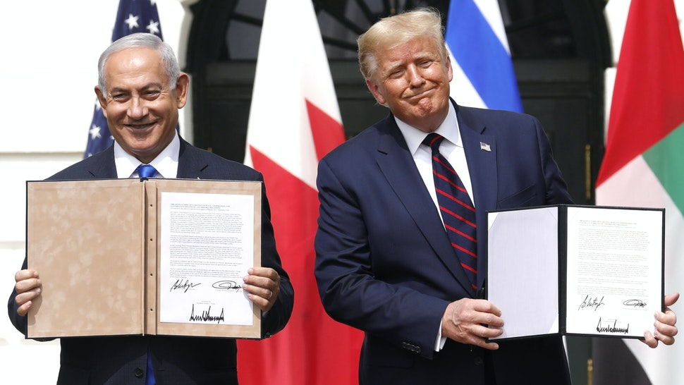 U.S. President Donald Trump and Benjamin Netanyahu, Israel's prime minister, left, hold signed documents during an Abraham Accords signing ceremony event on the South Lawn of the White House in Washington, D.C., U.S., on Tuesday, Sept. 15, 2020. The United Arab Emirates and Bahrain signed landmark agreements on Tuesday to move toward establishing normal relations with Israel, setting in motion a potentially historic shift in Mideast politics at a White House ceremony hosted by PresidentDonald Trump.