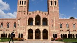 A student walks toward Royce Hall on the campus of University of California at Los Angeles (UCLA) in Los Angeles, California on March 11, 2020. - Starting this week many southern California universities including UCLA will suspend in-person classes due to coronavirus concerns. (Photo by Robyn Beck / AFP) (Photo by ROBYN BECK/AFP via Getty Images)