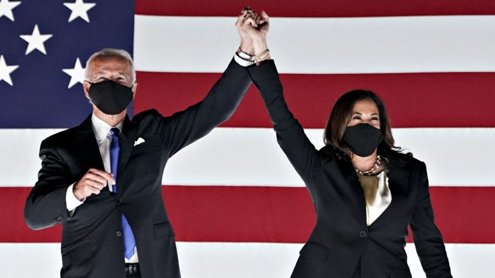 Former Vice President Joe Biden, Democratic presidential nominee, left, and Senator Kamala Harris, Democratic vice presidential nominee, wear protective masks while holding hands outside the Chase Center during the Democratic National Convention in Wilmington, Delaware, U.S., on Thursday, Aug. 20, 2020. Biden accepted the Democratic nomination to challenge President Donald Trump, urging Americans in a prime-time address to vote for new national leadership that will overcome deep U.S. political divisions. Photographer: