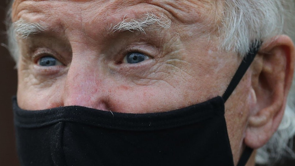 DETROIT, MICHIGAN - SEPTEMBER 09: Wearing a face mask to reduce the risk posed by the coronavirus, Democratic presidential nominee Joe Biden talks with members of the United Steelworkers union in a supporter's back yard September 09, 2020 in Detroit, Michigan. Biden is campaigning in Michigan, which President Donald Trump won in 2016 by less than 11,000 votes, the narrowest margin of victory in state's presidential election history. (Photo by