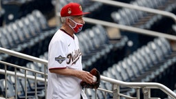WASHINGTON, DC - JULY 23: Dr. Anthony Fauci, director of the National Institute of Allergy and Infectious Diseases walks to the field to throw out the ceremonial first pitch prior to the game between the New York Yankees and the Washington Nationals at Nationals Park on July 23, 2020 in Washington, DC. (Photo by