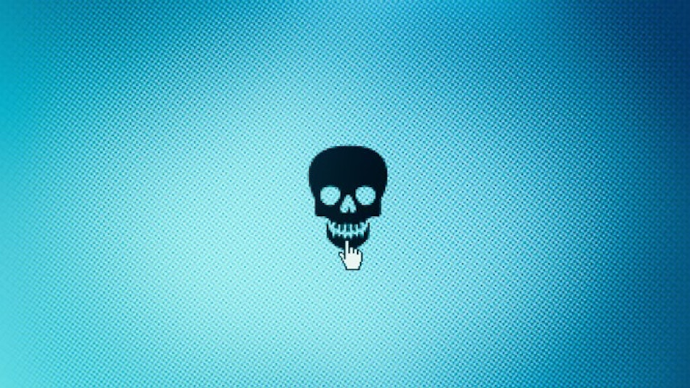Hacker -- cyber attack -- Close up of skull icon on monitor screen