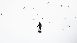 """CANNES, FRANCE - MAY 15: (EDITORS NOTE: This image has been digitally retouched) A jetpack flies over the screening of """"Solo: A Star Wars Story"""" during the 71st annual Cannes Film Festival at Palais des Festivals on May 15, 2018 in Cannes, France. (Photo by"""