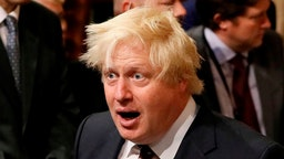 LONDON, UNITED KINGDOM - JUNE 21: British Foreign Secretary Boris Johnson walks through the House of Commons to attend the the State Opening of Parliament taking place in the House of Lords at the Palace of Westminster on June 21, 2017 in London, United Kingdom. This year saw a scaled-back State opening of Parliament Ceremony with the Queen arriving by car rather than carriage and not wearing the Imperial State Crown or the Robes of State. (Photo by