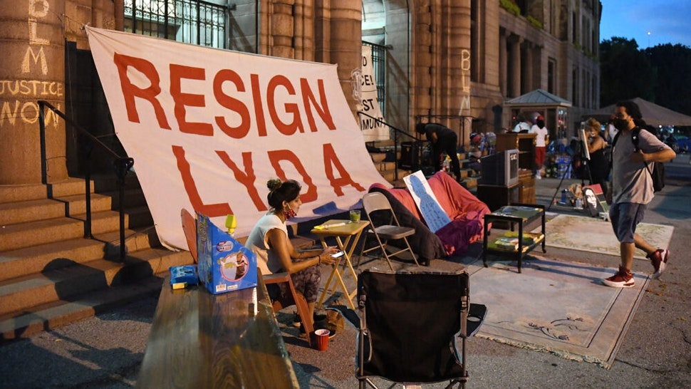 ST LOUIS, MO - JULY 09: Protesters occupy outside St. Louis City Hall on July 9, 2020 in St Louis, Missouri. Many Protesters are demanding the resignation of St. Louis City Mayor Lyda Krewson after she revealed names and addresses of Protesters calling for police reform.