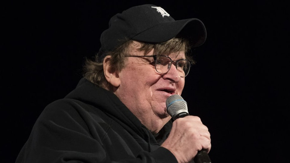 Michael Moore, American filmmaker, speaks during a campaign event for Senator Bernie Sanders, an Independent from Vermont and 2020 presidential candidate, during a town hall event in Rochester, New Hampshire, U.S., on Saturday, Feb. 8, 2020. Sanders is favored to win New Hampshire, but recent polls showed Pete Buttigieg cutting into his lead. Photographer: