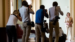 UNITED STATES - JUNE 25: News photographers gather in the Ohio Clock Corridor to photograph House Minority Leader Nancy Pelosi, D-Calif., and Senate Minority Leader Harry Reid, D-Nev., as they walk to their news conference in the Capitol on Thursday, June 25, 2015. (Photo By
