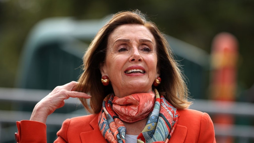 SAN FRANCISCO, CALIFORNIA - SEPTEMBER 02: U.S. Speaker of the House Nancy Pelosi (D-CA) adjusts her hair as she speaks during a Day of Action For the Children event at Mission Education Center Elementary School on September 02, 2020 in San Francisco, California. Nancy Pelosi is drawing criticism for patronizing a hair salon to get her hair done despite the salon being closed to in-person visits due to COVID-19 restrictions. (Photo by