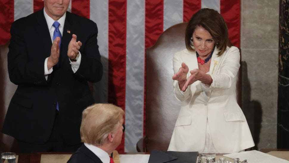 WASHINGTON, DC - FEBRUARY 05: Vice President Mike Pence and Speaker Nancy Pelosi greet President Donald Trump just ahead of the State of the Union address in the chamber of the U.S. House of Representatives at the U.S. Capitol Building on February 5, 2019 in Washington, DC. President Trump's second State of the Union address was postponed one week due to the partial government shutdown. (Photo by